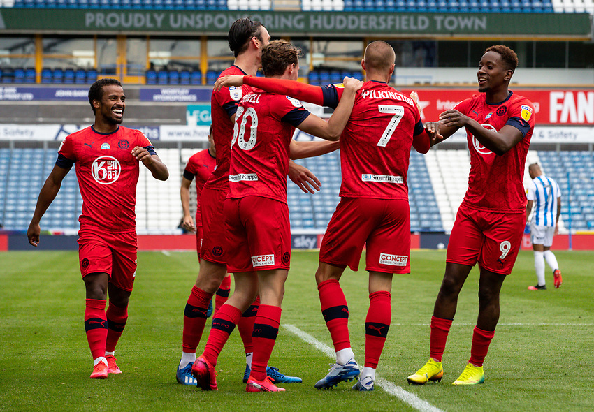 Wigan Athletic's Anthony Pilkington celebrates scoring his side's second goal with teammates<br /> <br /> Photographer Alex Dodd/CameraSport<br /> <br /> The EFL Sky Bet Championship - Huddersfield Town v Wigan Athletic - Saturday 20th June 2020 - John Smith's Stadium - Huddersfield <br /> <br /> World Copyright © 2020 CameraSport. All rights reserved. 43 Linden Ave. Countesthorpe. Leicester. England. LE8 5PG - Tel: +44 (0) 116 277 4147 - admin@camerasport.com - www.camerasport.com