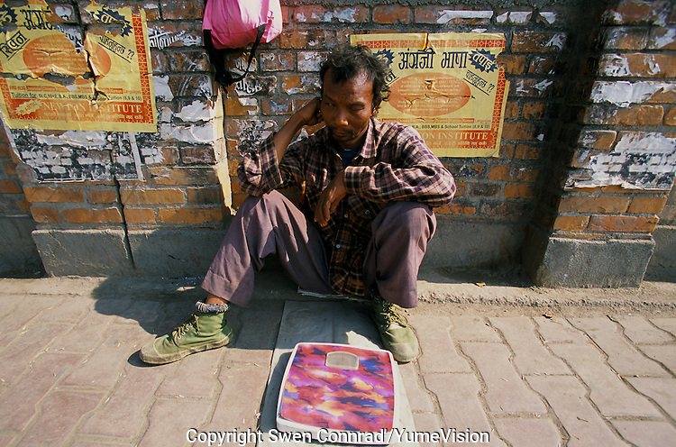 Weighing at the bus station in Kathmandu City, Nepal