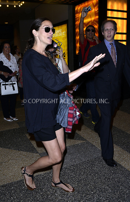 WWW.ACEPIXS.COM<br /> <br /> June 26 2013, New York City<br /> <br /> Actress Julia Roberts arriving at the Minskoff Theatre to see a performance of 'The Lion King' on June 26 2013 in New York City<br /> <br /> By Line: Curtis Means/ACE Pictures<br /> <br /> <br /> ACE Pictures, Inc.<br /> tel: 646 769 0430<br /> Email: info@acepixs.com<br /> www.acepixs.com