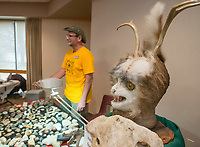 NWA Democrat-Gazette/BEN GOFF @NWABENGOFF<br /> Marty Powers of Fayetteville shows his collection of fossils and other objects, including a taxidermy creation of a fictional creature, Saturday, Jan. 12, 2019, during the annual collectors day 'Cabin Fever Reliever' at the Shiloh Museum of Ozark History in Springdale. Dozens of local collectors set up tables showcasing their collections of such various things as kitchen utensils, coins, buttons, hand fans, fossils woodcarving and much more.