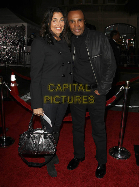 "BERNADETTE ROBI & SUGAR RAY LEONARD .""The Fighter"" Los Angeles Premiere held At The Grauman's Chinese Theatre,  Hollywood, CA, 6th December 2010..full length black wife husband couple jacket trousers bag .CAP/ADM/KB.©Kevan Brooks/AdMedia/Capital Pictures."