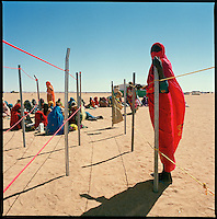 Oure Cassooni camp, Chad, Dec. 11, 2004..The food aid provided by the WFP to the  thousands Darfur refugees in Oure Cassoni camp has crossed more than 2500 km of Sahara desert from the Libyan port of Benghazi; the weekly convoy, 40 trucks strong, takes more than 20 days to  reach this isolated region.