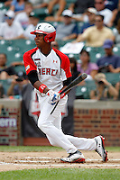 Outfielder Byron Buxton #11 at bat during the Under Armour All-American Game at Wrigley Field on August 13, 2011 in Chicago, Illinois.  (Mike Janes/Four Seam Images)