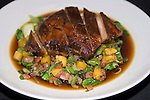 Honey Rum-glazed Pot Roast of Pork & Sauteed Shanghai Bok Choy & Fried Plantains & Enoki Mushrooms.Cuba de Asia Restaurant, New York, New York