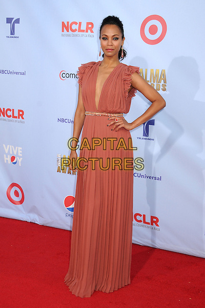 Zoe Saldana.2012 NCLR ALMA Awards - arrivals, held at The Pasadena Civic Auditorium, Pasadena, California USA..16th September 2012.full length dress belt pink plunging neckline hand on hip.CAP/ADM/BP.©Byron Purvis/AdMedia/Capital Pictures.