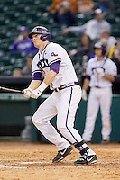 Kevin Cron #00 of the Texas Christian Horned Frogs watches the flight of his 3-run home run in the top of the ninth inning against the Sam Houston State Bearkats at Minute Maid Park on February 28, 2014 in Houston, Texas.  The Bearkats defeated the Horned Frogs 9-4.  (Brian Westerholt/Four Seam Images)