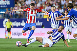 Atletico de Madrid's Kevin Gameiro and Deportivo Alaves's M. Llorente during the match of La Liga Santander between Atletico de Madrid and Deportivo Alaves at Vicente Calderon Stadium. August 21, 2016. (ALTERPHOTOS/Rodrigo Jimenez)