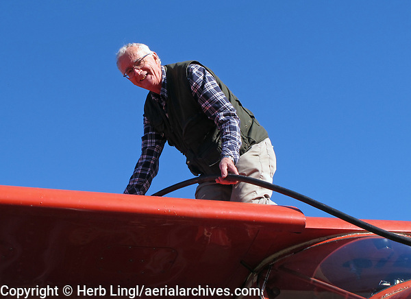 Seaplane pilot Paul Thomas fuels his Helio Courier on floats in Vareness, Quebec