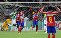MEDELLIN - COLOMBIA -14-03-2014: Ervin Maturana  jugador del Deportivo Pasto celebra el gol anotado al Atletico Nacional  durante partido de la Onceava fecha de la Liga Postobon I 2014, jugado en el estadio Atanasio Girardot de la ciudad de Medellin. / Ervin Maturana player of Deportivo Pasto  celebrates a goal scored against Alteico Nacional during a match for the eleventh date of the Liga Postobon I 2014 at the Atanasio Girardot stadium in Medellin city. Photo: VizzorImage  / Luis Rios / Str