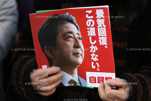 An elderly woman holds a manifesto of Japan's ruling Liberal Democratic Party (LDP) before an arrival of LDP lawmaker Shinjiro Koizumi's arrival for a speech to support  a candidate in Kawasaki city, Japan, on Saturday, December 13, 2014.  (Photo by Yuriko Nakao/AFLO)