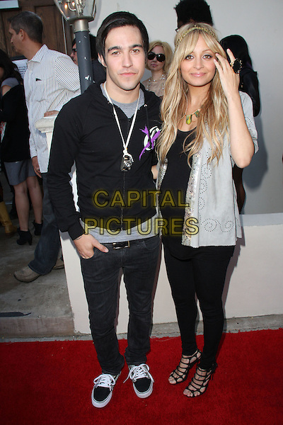 PETE WENTZ (FALL OUT BOY) & NICOLE RICHIE.House of Harlow 1960 & Clandenstine Industries Switch Boutique Runway Show held at Boulevard 3, Hollywood, California, USA. .June 4th, 2009 .full length black leggings top jacket hand silver grey gray pregnant strappy sandal.CAP/ADM/KB.©Kevan Brooks/AdMedia/Capital Pictures.