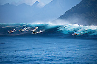 Surfers paddling after duck diving a set wave at a reef pass near Teahupoo, Tahiti, (Friday May 15 2009.) Photo: joliphotos.com