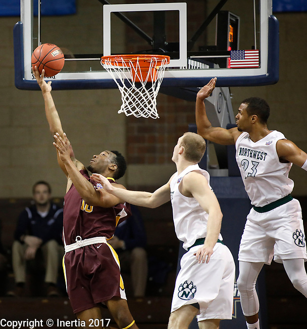 SIOUX FALLS, SD: MARCH 22: Daniel Wilson #10 of St. Thomas Aquinas gets a layup past Northwest Missouri State defenders during the Men's Division II Basketball Championship Tournament on March 22, 2017 at the Sanford Pentagon in Sioux Falls, SD. (Photo by Dick Carlson/Inertia)