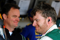 Nov. 13, 2009; Avondale, AZ, USA; NASCAR Sprint Cup Series driver Dale Earnhardt Jr (right) with crew chief Lance McGrew during practice for the Checker O'Reilly Auto Parts 500 at Phoenix International Raceway. Mandatory Credit: Mark J. Rebilas-