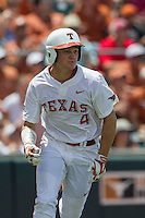 Texas Longhorns outfielder Collin Shaw (4) runs to first base during the NCAA Super Regional baseball game against the Houston Cougars on June 7, 2014 at UFCU Disch–Falk Field in Austin, Texas. The Longhorns are headed to the College World Series after they defeated the Cougars 4-0 in Game 2 of the NCAA Super Regional. (Andrew Woolley/Four Seam Images)