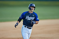 Jack Elliot (21) (Mercyhurst) of the Martinsville Mustangs rounds the bases after hitting a home run against the High Point-Thomasville HiToms at Finch Field on July 26, 2020 in Thomasville, NC.  The HiToms defeated the Mustangs 8-5. (Brian Westerholt/Four Seam Images)