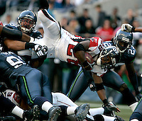 Atlanta's Warrick Dunn dives for extra yardage in the Seahawks home opener at Qwest Field in Seattle, Washington on Sunday Sept. 18, 2005(Kevin P. Casey/Wireimage.com)