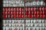 FRANCE - Stack of candles in French church Sainte-Catherine in Honfleur.<br /> Kaarsen staan verzameld in een rek om door geloving aangestoken te worden in de houten historische kerk Sainte-Catherine in Honfleur in Normandie, bekend om zijn gescheiden klokketoren. COPYRIGHT TON BORSBOOM