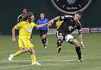 Santino Quaranta #25 of D.C. United pulls in a pass in front of Frankie Hejduk #2 of the Columbus Crew during a US Open Cup semi final match at RFK Stadium on September 1 2010, in Washington DC. Columbus won 2-1 aet.