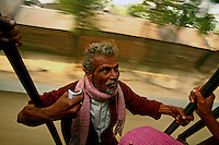 Travelling on the pedestals of train carriages is a common phenomenon in Bangladesh. The passengers pay half price to the conductor, discounted due to the lack of a seat.