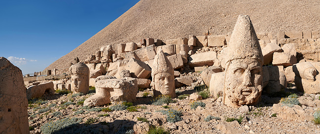 Statue head of from left,  Commagene, Apollo, Herekles & Eagle in front of the 62 BC Royal Tomb of King Antiochus I Theos of Commagene, west Terrace, Mount Nemrut or Nemrud Dagi summit, near Adıyaman, Turkey
