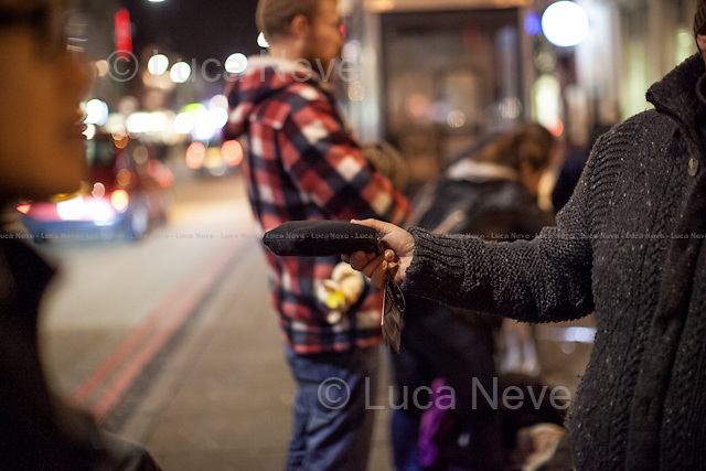 London, 16/12/2015. This evening, members of the public lead by &quot;Street Kitchens&quot; - a non-profit organisation that provides information and help for homeless people - met outside Camden Town Station for &quot;distributing and collecting essential items to those who may need them on our streets&quot;. Around 8:30PM, a small group of people moved towards King's Cross and Euston stations trying to help homeless people outside two of the major London's train stations. Wool hats, gloves, jumpers, trousers, shoes, tooth paste and brushes, coats, and then cups of tea and hot soups, sandwiches, water, bowls of rise, biscuits and a lot of company and smiles were donated this evening to the homeless people who are facing the London's cold winter. <br /> <br /> For more information please click here: http://www.streetskitchen.co.uk &amp; http://on.fb.me/1T3sCCt &amp; http://on.fb.me/1YmT4bE &amp; http://on.fb.me/1YmT8Iu <br /> <br /> 'Thoughts of Christmas': A Song to raise awareness and benefit our Streets - Please click here: http://bit.ly/21QkVWj<br /> <br /> EDIT - 11 APRIL 2016 - Following my return from Calais and Dunkirk camps in April 2016, news came to light of an ongoing court case that one of the people featured in these photo stories is involved in as a defendant. I had not known about this previously, and neither had Zekra, who is the organiser of &quot;Happy Ravers&quot; - one of the groups featured in these photostories. <br /> These photostories do show great work being done to help homeless people, and I will continue documenting this project. Though it is the job of the courts to reach a verdict (I do believe people are innocent until proven guilty), I have none the less decided that moving forward I will focus only on Zekra's work.