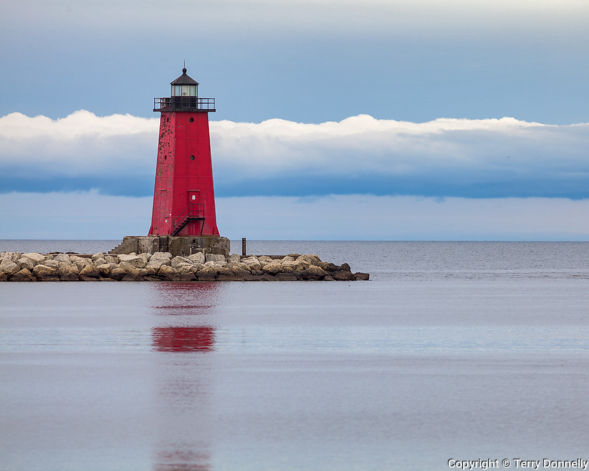 Manistique, Michigan<br /> Manistique East Breakwater Light with storm clouds over Lake Michigan, on Michigan's Upper Peninsula