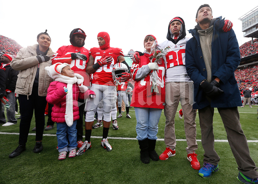 Ohio State Buckeyes wide receiver Chris Fields (80) and his family stand for the playing of the National Anthem after nineteen seniors were recognized before Saturday's NCAA Division I football game against Indiana at Ohio Stadium in Columbus on November 23, 2013. (Barbara J. Perenic/The Columbus Dispatch)