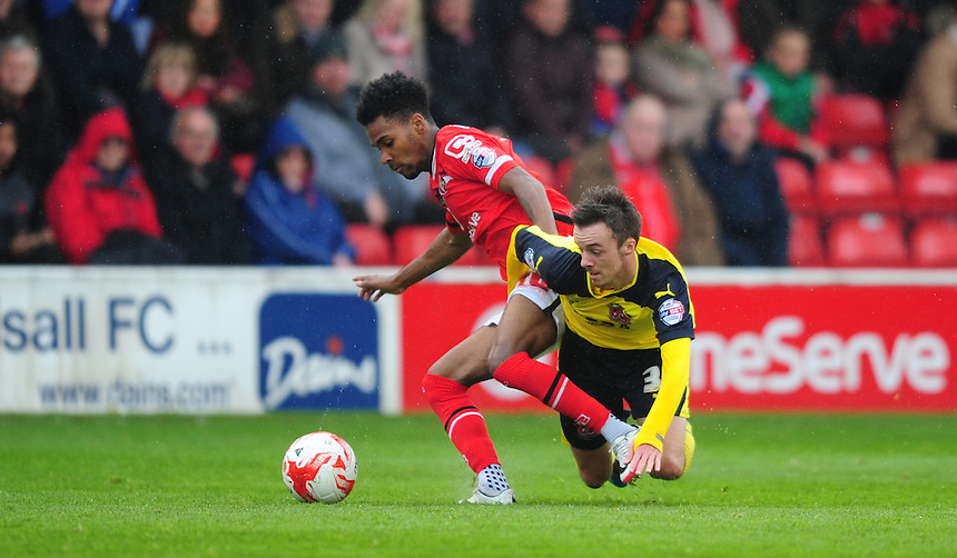 Fleetwood Town&rsquo;s Stefan Scougall vies for possession with Walsall's Rico Henry<br /> <br /> Photographer Chris Vaughan/CameraSport<br /> <br /> Football - The Football League Sky Bet League One - Walsall v Fleetwood Town - Monday 2nd May 2016 - Banks's Stadium - Walsall   <br /> <br /> &copy; CameraSport - 43 Linden Ave. Countesthorpe. Leicester. England. LE8 5PG - Tel: +44 (0) 116 277 4147 - admin@camerasport.com - www.camerasport.com