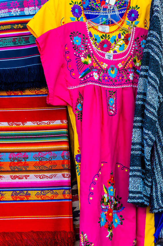 Mexican peasant blouses hanging outside a shop along Old Town Plaza, Albuquerque, New Mexico USA