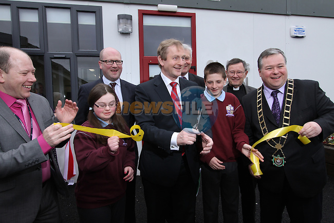 Megan Mccormack, Ciaran Jordan, Gerald Nash TD, Minister of State Fergus O'Dowd, Canon Jim Carroll, Principal Micheál Moley and Mayor Paul Bell with Taoiseach Enda Kenny as he visits St.Endas School in Drogheda to celebrate 50 Years Open and to Open the New Building...(Photo credit should read Jenny Matthews/NEWSFILE)...