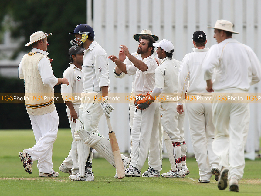 H Afridi og GRP takes the wicket of S McMurray, clean bowled, and celebrates - Gidea Park & Romford CC vs Ardleigh Green CC - Essex Cricket League - 16/08/08 - MANDATORY CREDIT: Gavin Ellis/TGSPHOTO - Self billing applies where appropriate - 0845 094 6026 - contact@tgsphoto.co.uk - NO UNPAID USE.