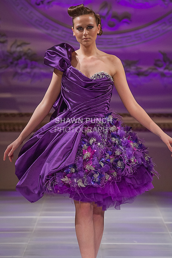 Model walks runway in an outfit from the Amal Sarieddine couture collection fashion show, during Couture Fashion Week Fall 2013 on February 16, 2013.