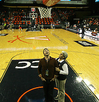 Photographer Ryan Kelly gets school of focus points for remote cameras by Tina  during an NCAA basketball game Saturday Feb, 24, 2014 in Charlottesville, VA. Virginia defeated Miami 65-40.