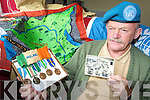Paddy Flynn Caragh Lake who was deployed by the Irish Defence Forces to the Congo 50 years ago looks at his medals and a picture of himself and his comrade at his home on Wednesday