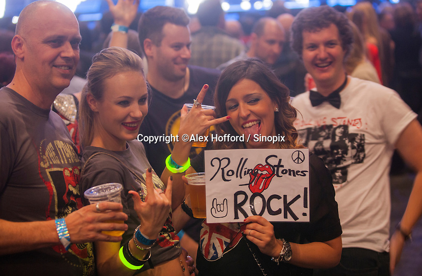 Fans of The Rolling Stones are seen at a sold out Rolling Stones concert in Macau, China, 09 March 2014. The show, which forms part of the '14 On Fire' tour, claims to be the biggest rock gig the small ex-Portuguese enclave in southern China has ever seen, with VIP packages to see the rock gods retailing online for around 14,800 Hong Kong dollars (Euro 1,375.00). The last time The Rolling Stones visited southern China was just over a decade ago for two sold out concerts in Hong Kong in 2003. The Rolling Stones '14 On Fire' tour will visit Abu Dhabi, Japan, Macau, Shanghai, Singapore, Australia and New Zealand.