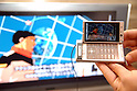 A mobile handset of SoftBank shows an animation movie on a TV screen. The company introduced new mobile handsets for spring in Tokyo.16 February, 2009. (Taro Fujimoto/JapanToday/Nippon News)