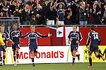 14 April 2007: New England's Taylor Twellman (20) greets teammates with open arms following his second goal of the game, scored in the 18th minute. The New England Revolution defeated Toronto FC 4-0 at Gillette Stadium in Foxboro, Massachusetts in an MLS Regular Season game.