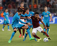 Calcio, Champions League, Gruppo E: Roma vs Barcellona. Roma, stadio Olimpico, 16 settembre 2015.<br /> Roma&rsquo;s Mohamed Salah, right, is challenged by FC Barcelona&rsquo;s Gerard Pique&rsquo;, left, and Sergi Roberto, during a Champions League, Group E football match between Roma and FC Barcelona, at Rome's Olympic stadium, 16 September 2015.<br /> UPDATE IMAGES PRESS/Isabella Bonotto