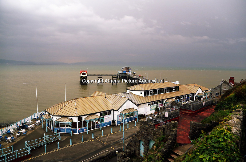 """Mumbles Pier at the seaside village of Mumbles near Swansea, UK. Monday 16 October 2017<br /> Re: Remnants of Hurricane Ophelia are expected to bring strong gusts of wind to Wales when it hits Britain's shores.<br /> The hurricane, making its way from the Azores in the Atlantic Ocean, will have weakened to a storm when it arrives.<br /> A Met Office amber """"be prepared"""" warning has been issued in some areas bringing """"potential danger to life""""."""