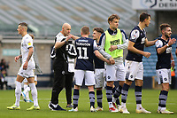 Millwall Caretaker Manager, Adam Barrett congratulates the Millwall players after their victory at the final whistle during Millwall vs Leeds United, Sky Bet EFL Championship Football at The Den on 5th October 2019