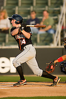 Tyler Kelly #14 of the Delmarva Shorebirds follows through on his swing against the Kannapolis Intimidators at Fieldcrest Cannon Stadium May 12, 2010, in Kannapolis, North Carolina.  Photo by Brian Westerholt / Four Seam Images