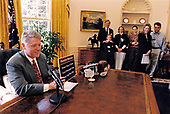 United States President Bill Clinton speaks to the nation about health care during his weekly radio address from the Oval Office of the White House in Washington, DC on Saturday, March 19, 1994.  He plans to travel to Deerfield Beach, Florida on Monday to talk with senior citizens about his Health Care Reform Plan.<br /> Credit:  White House via CNP