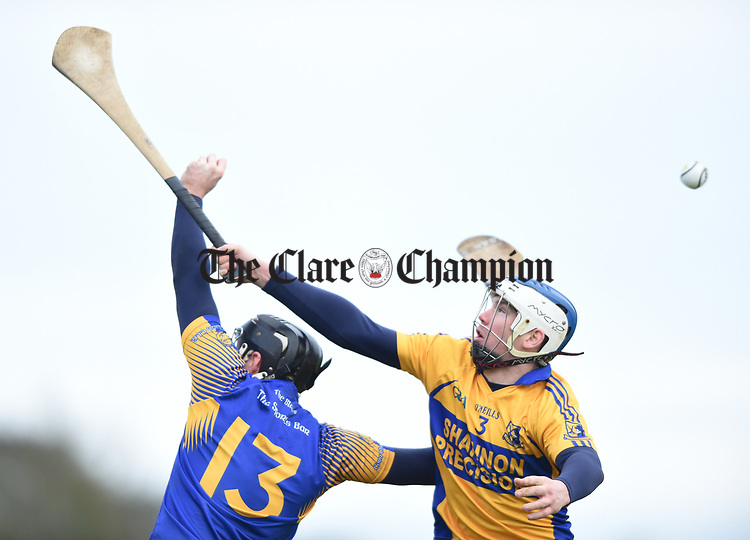 Colin Ryan of  Newmarket  in action against Aidan Quilligan of  Sixmilebridge during their Clare Champion Cup final at Clonlara. Photograph by John Kelly.