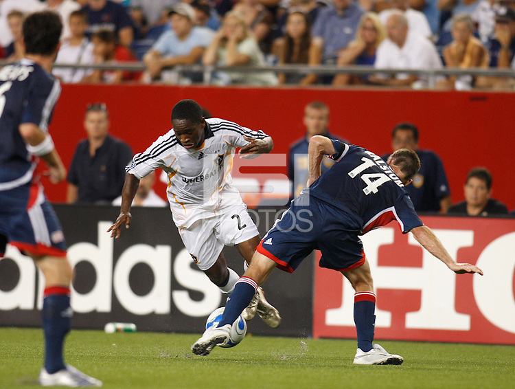 Los Angeles Galaxy defender (2) Mike Randolph gets tripped up by New England Revolution midfielder (14) Steve Ralston. The New England Revolution defeated the Los Angeles Galaxy  1-0 during an MLS regular season match at Gillette Stadium, Foxborough, MA, on August 12, 2007.
