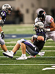 TCU Horned Frogs quarterback Andy Dalton #14 takes a hit during the game between the Oregon State Beavers and the TCU Horned Frogs at the Cowboy Stadium in Arlington,Texas. TCU defeated Oregon State 30-21.