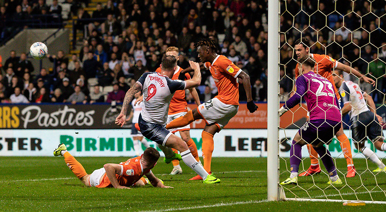 Blackpool's Armand Gnanduillet (centre) clears a goal mouth scramble<br /> <br /> Photographer Andrew Kearns/CameraSport<br /> <br /> The EFL Sky Bet League One - Bolton Wanderers v Blackpool - Monday 7th October 2019 - University of Bolton Stadium - Bolton<br /> <br /> World Copyright © 2019 CameraSport. All rights reserved. 43 Linden Ave. Countesthorpe. Leicester. England. LE8 5PG - Tel: +44 (0) 116 277 4147 - admin@camerasport.com - www.camerasport.com