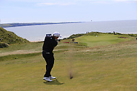 Paul Dunne (IRL) plays his 2nd shot on the 6th hole and almost holes it during Thursday's Round 1 of the Dubai Duty Free Irish Open 2019, held at Lahinch Golf Club, Lahinch, Ireland. 4th July 2019.<br /> Picture: Eoin Clarke | Golffile<br /> <br /> <br /> All photos usage must carry mandatory copyright credit (© Golffile | Eoin Clarke)
