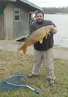 Courtesy photo<br /> Jorge Rojas shows a Lake Fayettevill carp he caught last winter. Rojas uses bread sprinkled with vanilla extract to catch big carp.