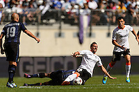 Valencia C. F. forward Paco Alcacer (25) is fouled. Valencia C. F. defeated F.C. Internazionale Milano 4-0 during round two of the 2013 Guinness International Champions Cup at MetLife Stadium in East Rutherford, NJ, on August 04, 2013.